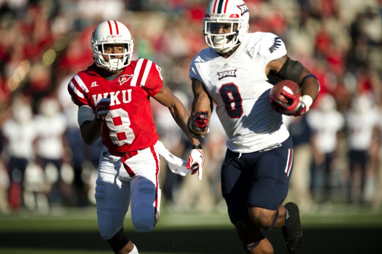 FAU+wide+receiver+Daniel+McKinney+keeps+one+step+ahead+of+WKU+wide+receiver+Marcus+Vasquez+to+score+a+touchdown+during+the+Hilltoppers+vs.+Florida+Atlantic+game+on+Saturday%2C+November+10%2C+2012.+FAU+upset+WKU+in+their+second+to+last+home+game+with+a+final+score+of+37-28.%C2%A0%0A
