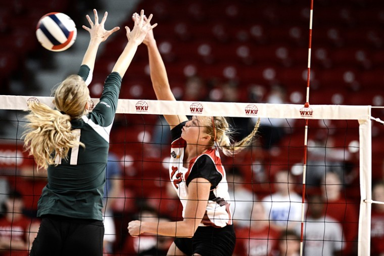Senior+outside+hitter+Jordyn+Skinner+spikes+the+ball+against+North+Texas+to+score+a+point.+WKU+won+the+2012+Sun+Belt+Conference+Volleyball+Championship+3-0+against+North+Texas+on+Saturday+Nov.+17%2C+2012+at+Diddle+Arena.%0A