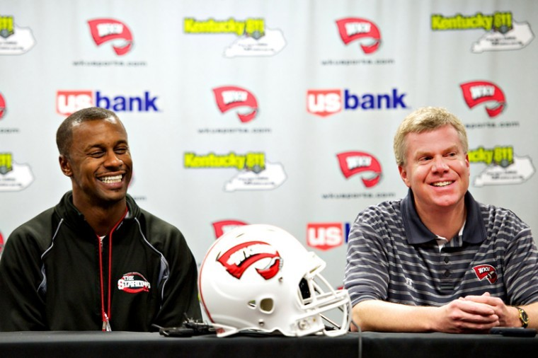 Head+football+coach+Willie+Taggart+%28left%29+and+Athletic+Director+Stewart+laugh+during+a+press+conference+Sunday%2C+Dec.+2%2C+2012+at+Diddle+Arena.+Western+Kentucky+will+make+its+first+postseason+debut+in+history+by+playing+Central+Michigan+in+the+Little+Ceasers+Pizza+Bowl+at+Ford+Field+in+Detroit.%C2%A0%0A
