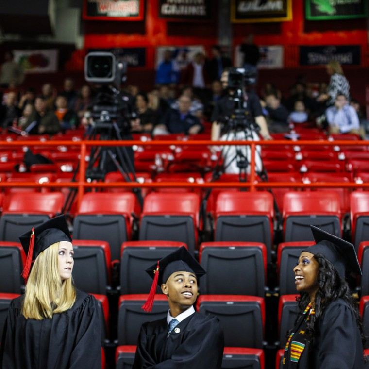 Graduates wait in line during the fall 2012 commencement ceremony in Diddle Area on Saturday Dec. 15.