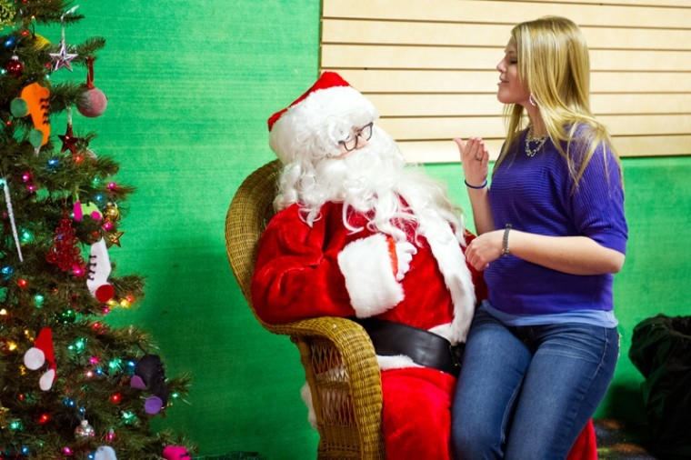 Bardstown junior Kelsey Sympson signs with Santa at the Skate Box on Saturday.