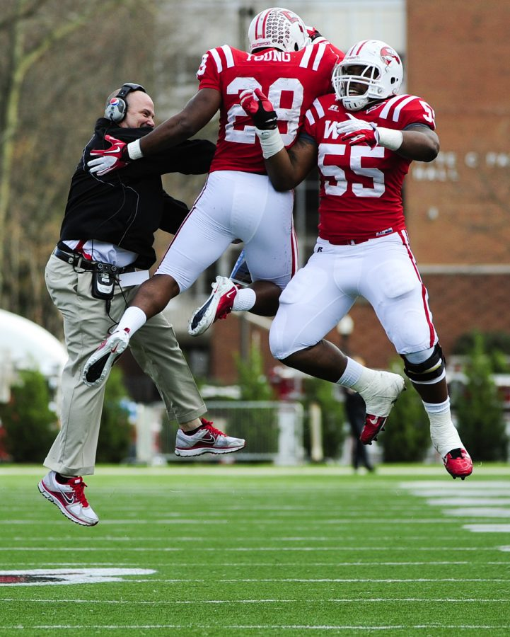 WKU+players+and+defensive+coordinator+Lance+Guidry+celebrate%0Aafter+Kiante+Young%27s+interception+in+the+fourth+quarter+of+WKU%27s%0A41-18+win+over+Troy.%0A