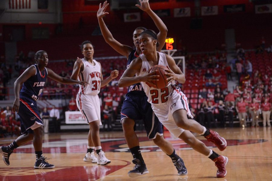Junior guard Bianca McGee passes the ball during Saturday's game against Florida Atlantic. The Lady Toppers won 86-68.