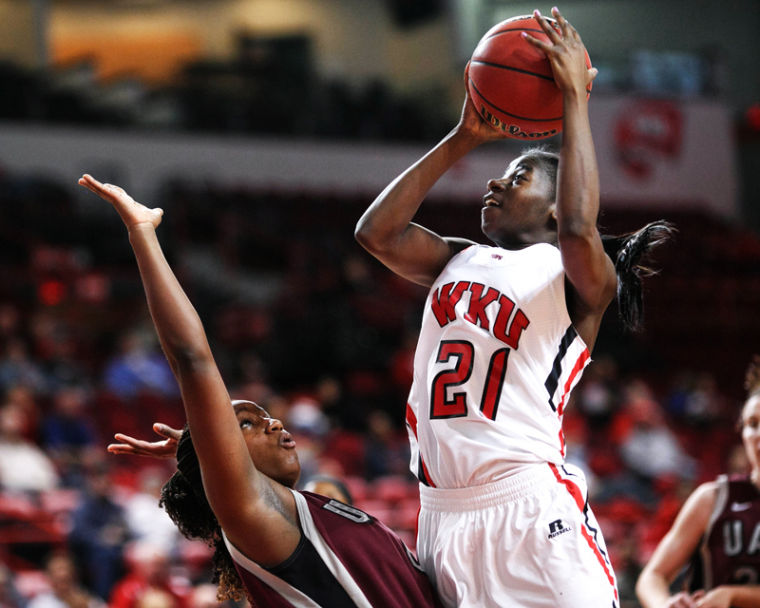 Sophomore guard Alexis Govan drives to the basket against UALR in the first half at E.A. Diddle Arena.