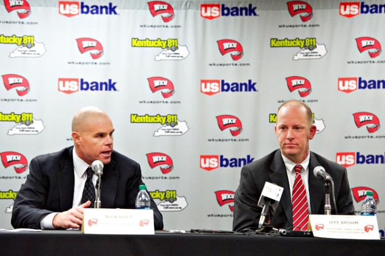Newly-hired+defensive+coordinator+Nick+Holt+%28left%29%2C+and+assistant+head+coach+and+offensive+coordinator+Jeff+Brohm+speak+during+a+press+conference+Wednesday%2C+Jan.+2%2C+at+Diddle+Arena%2C+Head+coach+Bobby+Petrino+recently+hired+Holt+and+Brohm%2C+along+with+seven+other+assistant+coaches.%C2%A0%0A