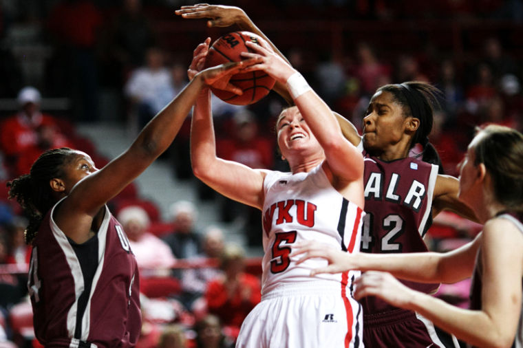 Freshman guard Micah Jones (5) goes up for a rebound against UALR in the second half at E.A. Diddle Arena.