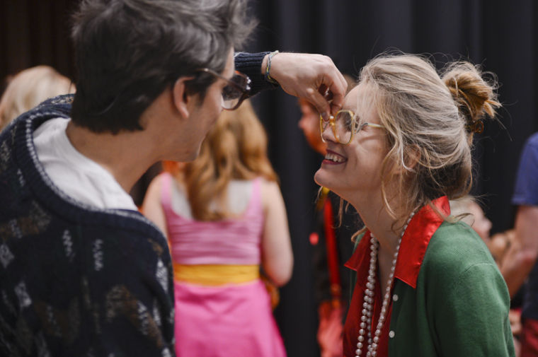 Louisville Fiji senior Ben Aroh fixes the glasses of his girlfriend, Louisville Alpha Omicron Pi sophomore Christen Profancik. Aroh and Profancik, who won the Beauty and the Greek pageant, dressed up as an elderly couple for the interview portion. KATIE MCLEAN/HERALD