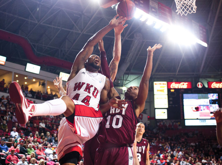 Sophomore forward George Fant fights for rebound during WKUs game against Troy.