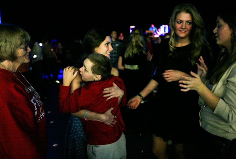 Caroline Cook, 16, of Bowling Green dances with Logan Reece, 18, during Jesus Prom at Hillview Heights church on Friday night. During Jesus Prom, people with special needs are paired with caregivers for the evening and given the opportunity to experience prom.