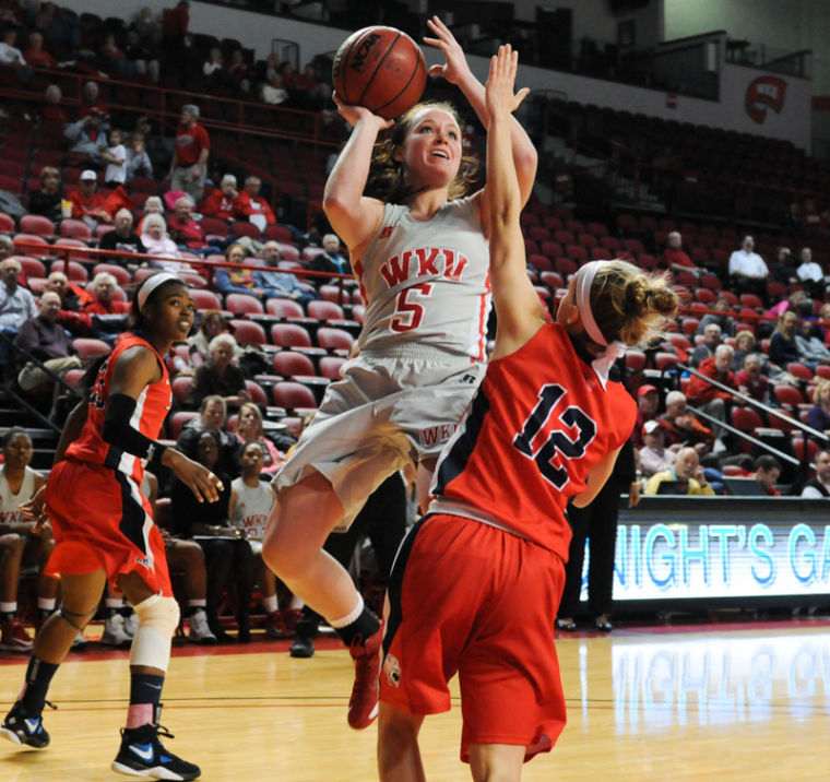 Freshman+guard+Micah+Jones+puts+up+a+shot+against+a+South+Alabama+defender.+The+Lady+Hilltoppers+lost+65-59.%0A