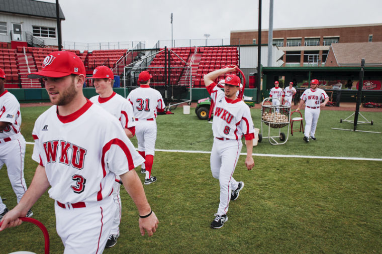 WKU+senior+infielder+Steve+Hodgins+helps+set+up+chairs+in+preparation+for+the+official+team+picture+at+Media+Day+on+Feb.+12.+With+plenty+of+talent+returning+this+season%2C+including+many+newcomers%2C+the+Hilltoppers+expect+to+improve+on+their+25-33+record+a+season+ago.%0A
