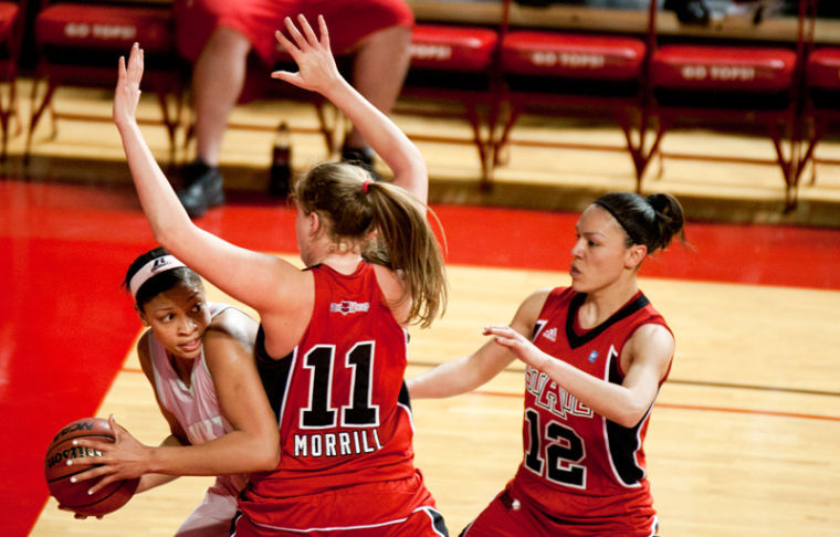 Sophomore guard Chastity Gooch (#30) defends against Arkansas State forward Jane Morrill (#11) and guard Ashley Olvera (#12) during their game Saturday.