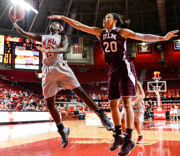 Sophomore+guard+Alexis+Govan+jumps+for+a+rebound+during+the+WKU+vs+ULM+game+at+Diddle+Arena+in+Bowling+Green%2C+Ky.+on+Wednesday+February+20.%0A