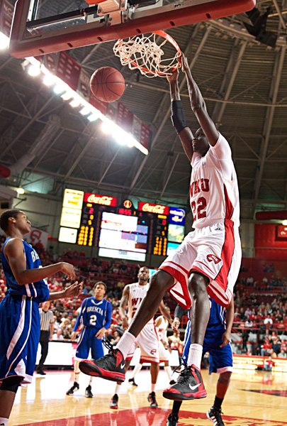 Senior+center+Teeng+Akol+dunks+the+ball+against+Brescia.+Akol+had+11+points+in+the+game.+WKU+won+74-46+against+Brescia+on+Saturday+Nov.+24%2C+2012+at+Diddle+Arena.%0A