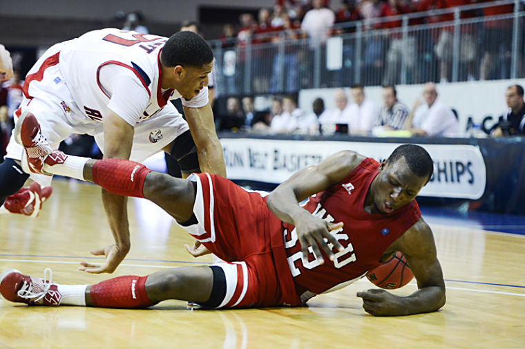 Sophomore+guard+T.J.+Price+and+South+Alabama+junior+forward+Augustine+Rubit+dive+for+a+loose+ball+during+the+second+half+of+their+second+round+Sun+Belt+Conference+Tournament+game.%0A