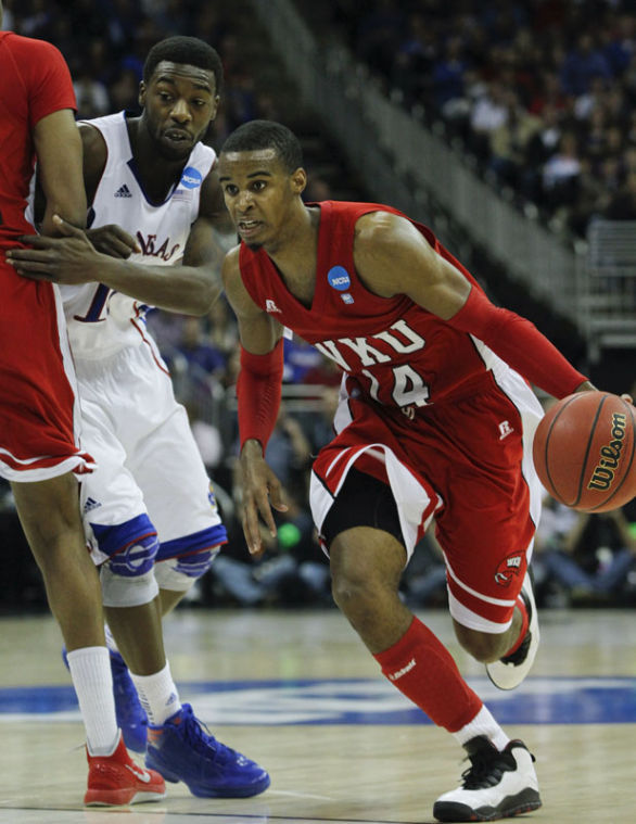 WKU+senior+guard+Jamal+Crook+%28%2314%29+brings+the+ball+down+court+during+the+second+half+March+22+at+the+Sprint+Center+in+Kansas+City%2C+Mo.+KU+beat+WKU+64-57.%0A