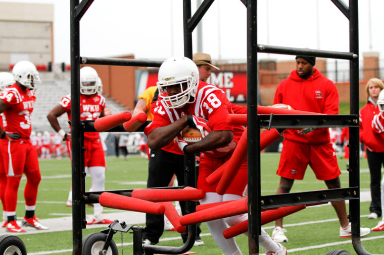 Sophomore+running+back+Darmontre+Warr+completes+a+running+drill+during+the+WKU+football+team%27s+first+spring+practice+on+March+22%2C+2013.%0A