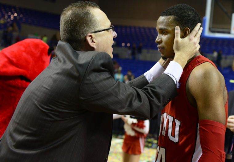 WKU+Head+Coach+Ray+Harper+congratulates+senior+guard+Jamal+Crook+after+winning+the+Sun+Belt+Conference+Tournament+championship+game.%0A