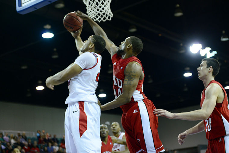 Sophomore forward George Fant attemps to block a shot by South Alabama junior forward Augustine Rubit in the first half of their Sun Belt Conference Game.