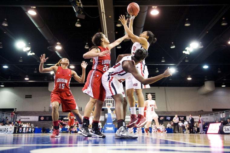 Junior+guard+Bianca+McGee+shoots+over+teammate+sophomore+guard+Alexis+Govan+and+Louisiana-Lafayette+freshman+guard+Keke+Veal+in+the+second+half+of+their+Sunbelt+Conference+tournament+game+in+Hot+Springs%2C+Ark.%C2%A0%0A