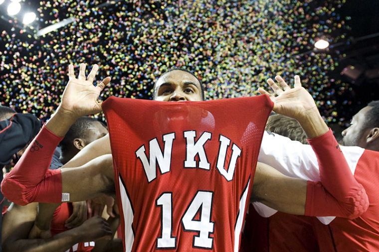 Senior+guard+Jamal+Crook+holds+out+his+jersey+while+celebrating+WKU%27s+win+over+Flordia+International+in+the+Sun+Belt+Conference+Tournament+final+to+clinch+a+spot+in+the+NCAA+tournament.%0A