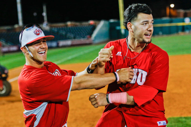 Senior+catcher+Devin+Kelley%2C+right%2C+and+graduate+assistant+Casey+Dykes+celebrate+after+Toppers+beat+Louisville+6-5+at+Bowling+Green+Ballpark%2C+Tuesday.%0A