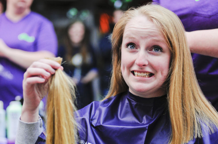 Omega+Phi+Alpha+Bellevue+sophomore+Paige+Smith+shows+her+support+of+those+suffering+from+childhood+cancer+by+donating+more+than+12+inches+of+hair+during+the+St.+Baldrick%27s+event.+The+donated+hair+goes+to+Pantene%27s+Beautiful+Lengths+program%2C+which+makes+wigs+for+women+with+cancer.%0A