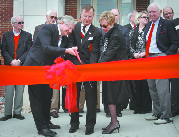 Alumni Association President Dale Augenstein, WKU President Dr. Gary Ransdell, and Vice President for Development and Alumni Relations Kathryn Costello cut the ribbon to officially open the Augenstein Alumni Center on Friday.