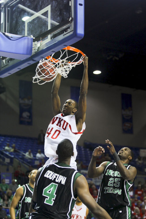Jeremy Evans (40) dunks as North Texas players George Odufuwa and Eric Tramiel watch during the Sun Belt Championships in 2009 in Hot Springs, Ark. Evans has been playing for the Utah Jazz the past three seasons.
