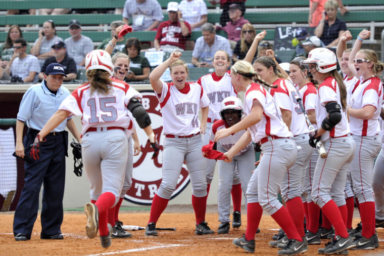Sophomore+infielder+Preslie+Cruce%2C+from+Empire%2C+Ala%2C+is+greeted+by+her+teammates+at+home+plate+after+hitting+a+2-run+home+run+against+USC+Upstate.+WKU+won+3-0+against+USC+Upstate+in+their+first+NCAA+Regional+Softball+Tournament+game+at+Rhoads+Stadium+in+Tuscaloosa%2C+Ala+on+Friday+May+17%2C+2013.%0A