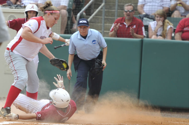 Junior pitcher Emily Rousseau tries to tag out a runner stealing home after a pitch is under thrown. WKU lost 13-1 against Alabama in the Tuscaloosa NCAA Regional Softball Championship game at Rhoads Stadium in Tuscaloosa, Ala. on Sunday May 19, 2013.