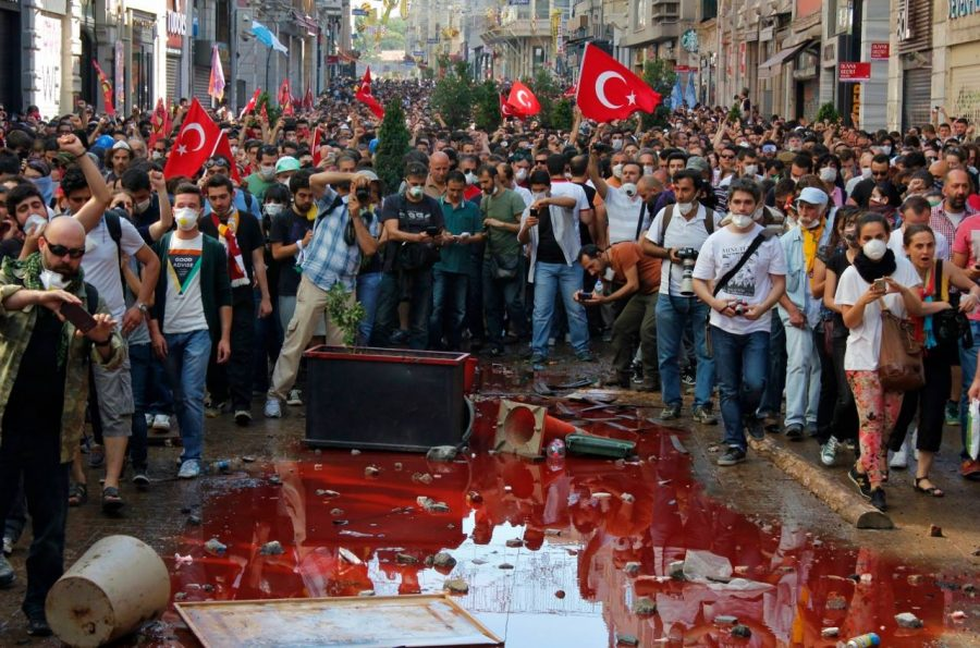 The red chemicals shot from police water canons lie in a pool of debris and dirt in the middle of Istiklal, Turkey following the withdrawal of the police force on June 1.