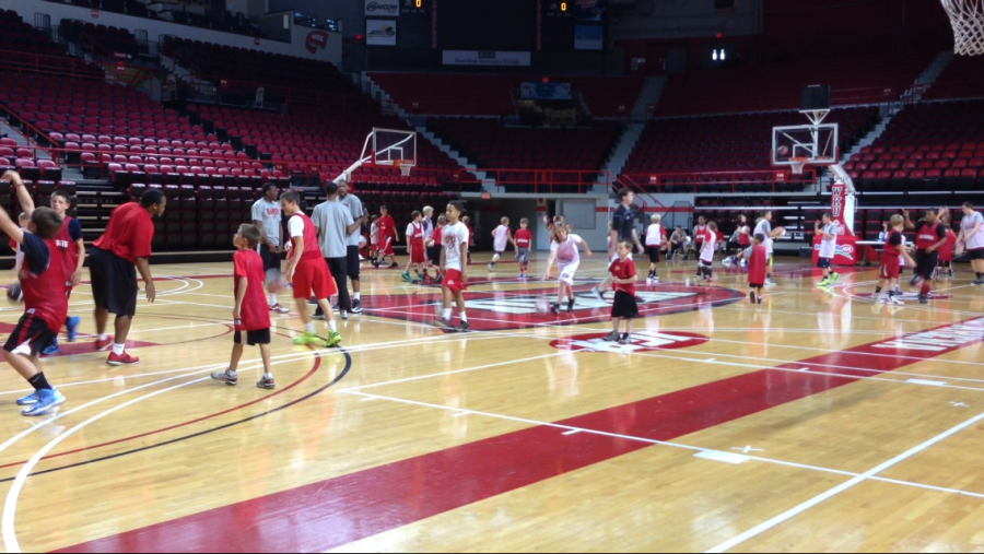 Boys+from+ages+7+and+up+participate+in+Ray+Harpers+Basketball+Camp+in+Diddle+Arena.%0A