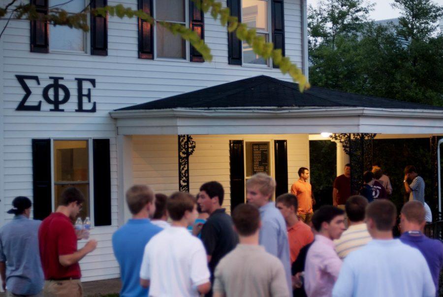 Fall formal rush fraternity recruits mingle outside the new Sigma Phi Epsilon house.