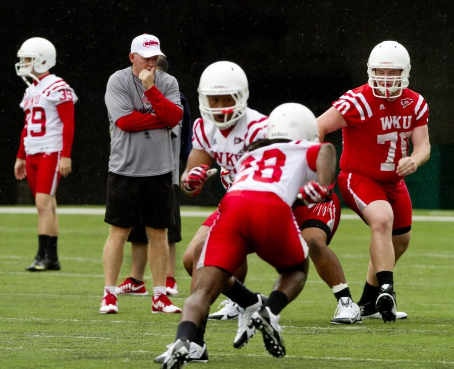 Coach+Bobby+Petrino+%28second+from+left%29+watches+his+team+during+practice+at+Smith+Stadium+on+Monday%2C+August+5.+%28Shelby+Mack+%2F+Herald%29