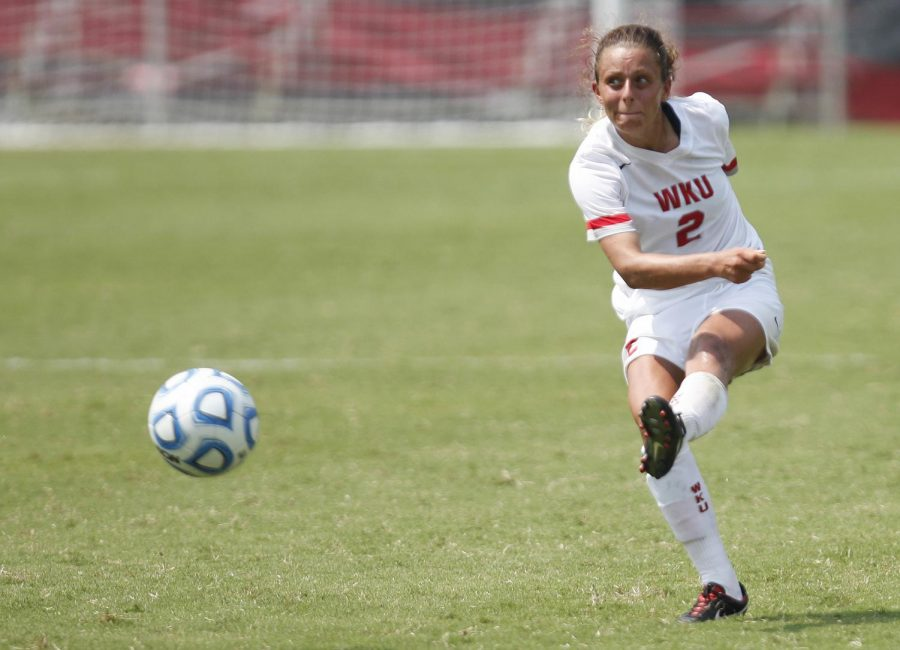 WKU+senior+midfielder+Andrea+Curry+passes+the+ball+during+the+Toppers%27+season+opener+against+Utah.+The+Toppers+would+lose+the+game+0-2.%C2%A0