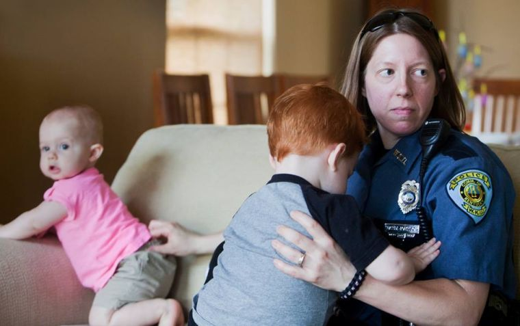 In this 2012 photo, Mandi Johnson is holding onto her two children. Until recently, Johnson worked as a public information officer at WKU.