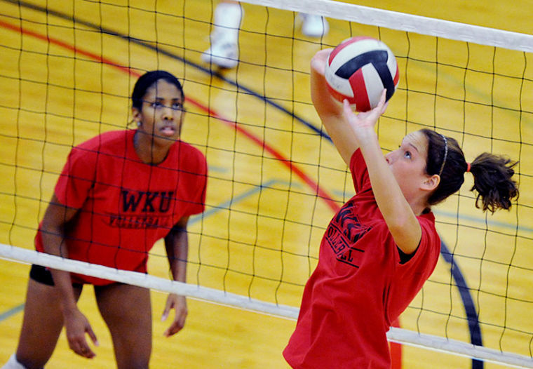 Senior+setter+Melanie+Stutsman+sets+the+ball+during+practice+on+Tues.+Aug.+27%2C+2013.+WKU+has+their+first+match+on+Friday+against+Alabama+A%26amp%3BM.