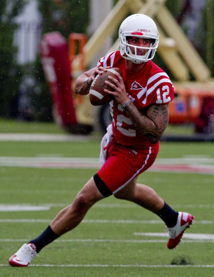 Junior+quarterback+Brandon+Doughty+steps+back+to+take+a+throw+during+WKU%27s+first+practice+of+Fall+Camp.+Photo+by+Shelby+Mack.