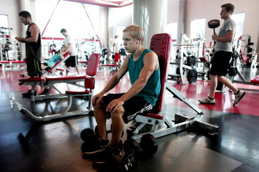 Crestwood freshman Joey Badinger rests while lifting weights at the Preston Center on Wednesday, August 28.