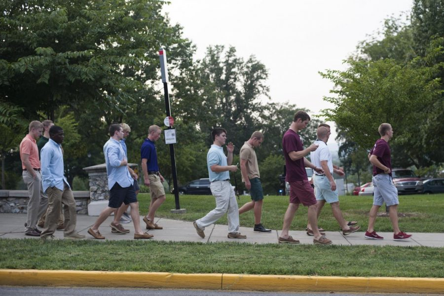 Freshmen recruits follow their assigned Rho Alpha to the Kappa Alpha house during formal fall fraternity recruitment week.