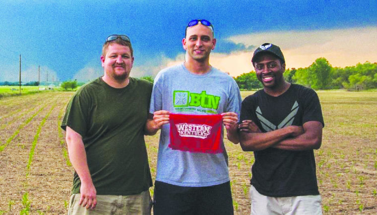 WKU alumni Kyle Berry, Landon Hampton and Nathaniel Shearer pose for a photo in front of a storm in Bennington, Kan. on May 28. The crew witnessed a wedge EF4 tornado.