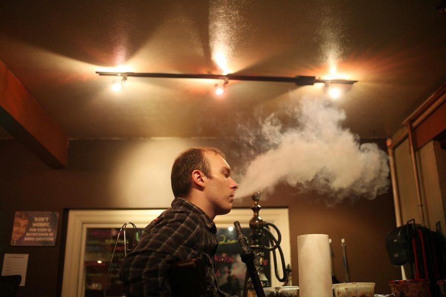 WKU graduate, Quentin Walker exhales his blackberry-lemon flavored hookah at Cloud 9 in Bowling Green. Walker said he enjoys the atmosphere of Cloud 9.