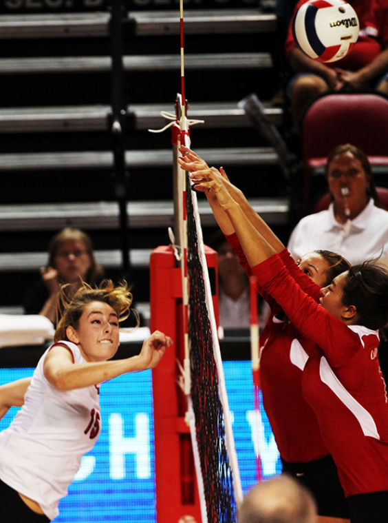 WKU sophomore offensive hitter, Rachel Engle, Floyds Knob, IN., sends a spike past University of Cincinatti blockers. WKU brought in 42 total kills with only eight attack errors and defeated the Bearcats, 3-0.