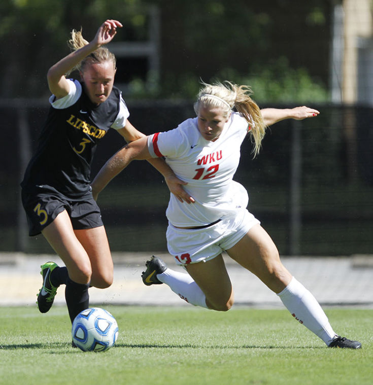 Freshman+Iris+Dunn+fights+off+Lipscomb+freshman+defender+Carlotta+Fennefoss+while+attempting+to+gain+control+of+the+ball+during+their+game+Sunday.