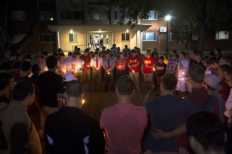 WKU+students+gather+for+a+candle+light+vigil+outside+of+McCormack+Hall+for+Cory+Beavin+Saturday%2C+September+28%2C+2013.%C2%A0