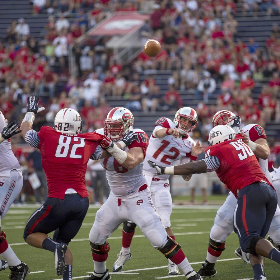 Davie%2C+Fl.+redshirt+Junior+Brandon+Doughty+%2812%29+throws+through+traffic+during+the+first+half+of+WKU%E2%80%99s+game+against+Southern+Alabama+Sept.+14%2C+2013+at+Ladd+-+Pebbles+Stadium+in+Mobile+Ala.