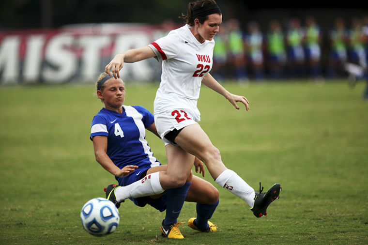 WKU+Sophomore+defender%2C+Alanna+Clancey%2C+of+Carmel%2C+IN%2C+rushes+past+University+of+Memphis+sophomore+defender+Elysia+Masters.+The+Lady+Toppers+lost+to+the+Memphis+Tigers%2C+1-0.%C2%A0