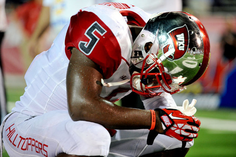 WKU+running+back+Antonio+Andrews+kneels+on+the+field+after+losing+the+game+to+South+Alabama.%C2%A0