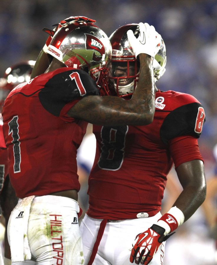 WKU+junior+safety+Jonathan+Dowling+talks+to+freshman+defensive+back+Marcus+Ward+during+a+video+review+on+a+fumble+play+against+Kentucky+at+LP+Field+in+Nashville%2CTn.